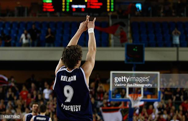 Dmitry Kulagin of Triumph celebrates after winning the FIBA Europe EuroChallenge Final Four third place game between Szolnoki Olaj and Triumph...