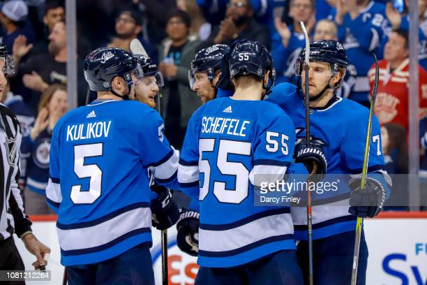 Dmitry Kulikov Kyle Connor Blake Wheeler Mark Scheifele and Ben Chiarot of the Winnipeg Jets celebrate a first period goal against the Detroit Red...