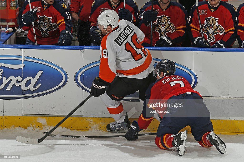 Dmitry Kulikov #7 of the Florida Panthers attempts to check the puck away from Scott Hartnell #19 of the Philadelphia Flyers at the BB&T Center on April 8, 2014 in Sunrise, Florida. The Flyers defeated the Panthers 5-2.