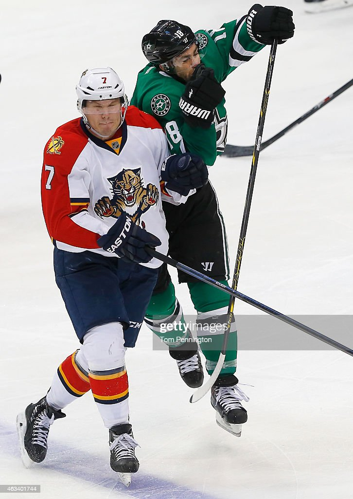 Dmitry Kulikov #7 of the Florida Panthers collides with Patrick Eaves #18 of the Dallas Stars in the third period at American Airlines Center on February 13, 2015 in Dallas, Texas.