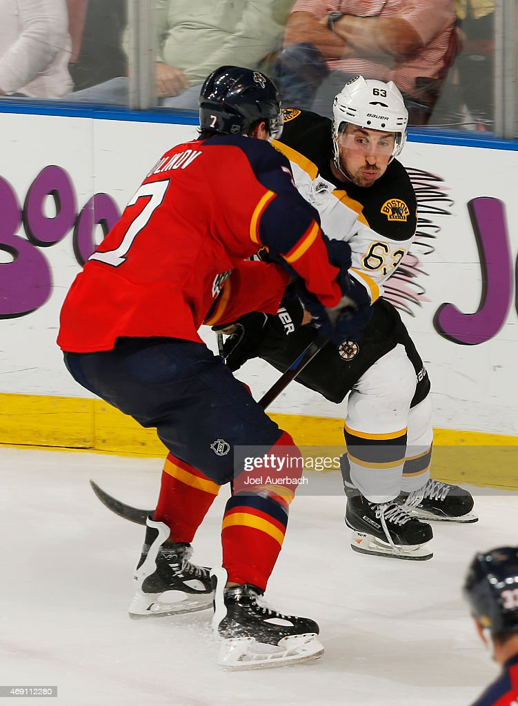 Dmitry Kulikov #7 of the Florida Panthers defends against Brad Marchand #63 of the Boston Bruins during third period action at the BB&T Center on April 9, 2015 in Sunrise, Florida. The Panthers defeated the Bruins 4-2.