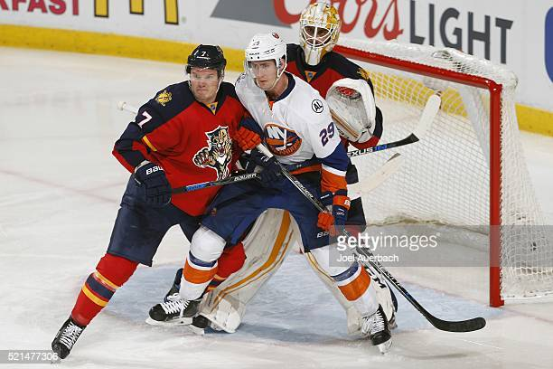 Dmitry Kulikov of the Florida Panthers defends against Brock Nelson of the New York Islanders as he gets into position in front of Goaltender Roberto...