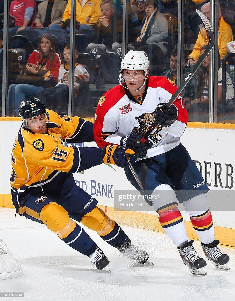 Dmitry Kulikov #7 of the Florida Panthers skates against Craig Smith #15 of the Nashville Predators at Bridgestone Arena on October 15, 2013 in Nashville, Tennessee.