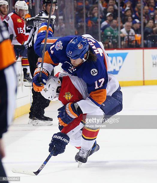Dmitry Kulikov of the Florida Panthers takes a penalty for clipping Matt Martin of the New York Islanders during the second period during Game Three...