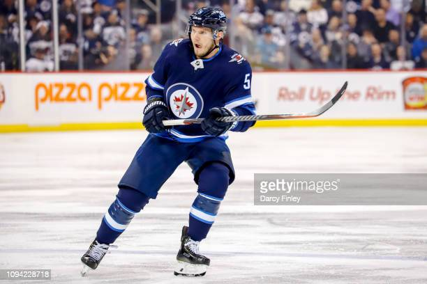 Dmitry Kulikov of the Winnipeg Jets keeps an eye on the play during second period action against the San Jose Sharks at the Bell MTS Place on...