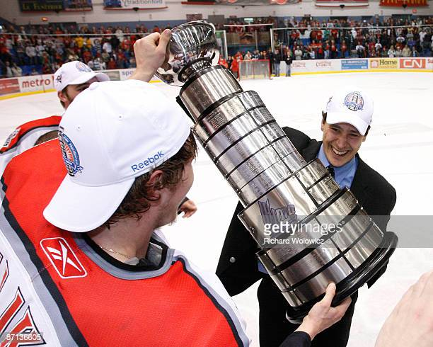 Dmitry Kulikov presents the Presidents Cup to Drummondville Voltigeurs head coach Guy Boucher after defeating the Shawinigan Cataractes 32 in Game 7...