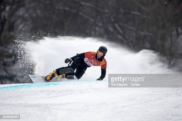 Dmitry Loginov an Olympic Athlete from Russia in action during the Men's Snowboard Parallel Giant Slalom competition at Phoenix Snow Park on February...