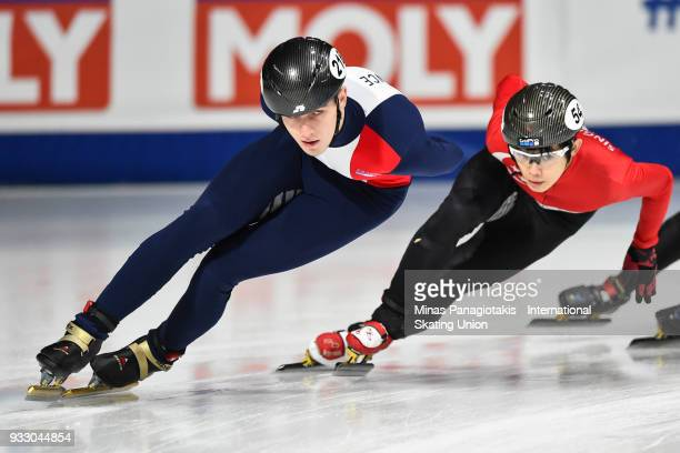Dmitry Migunov of France competes against Lucas Ng of Singapore in the men's 1500 meter ranking finals during the World Short Track Speed Skating...