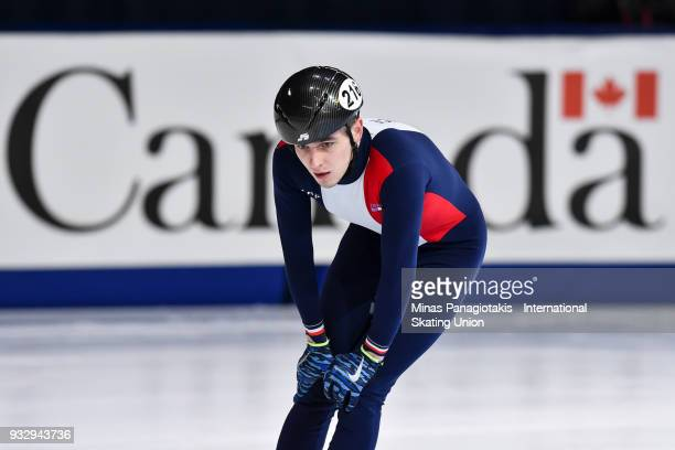 Dmitry Migunov of France competes in the men's 1500 meter heats during the World Short Track Speed Skating Championships at Maurice Richard Arena on...