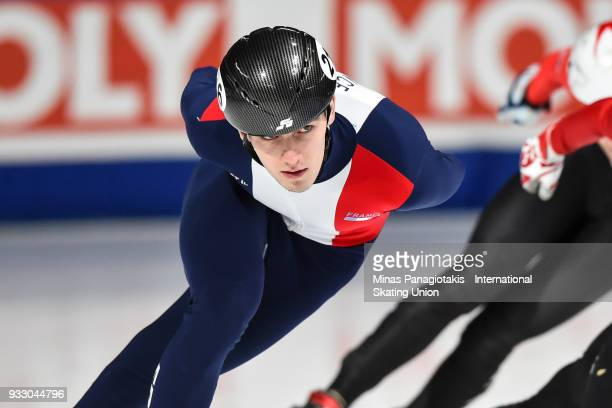 Dmitry Migunov of France competes in the men's 1500 meter ranking finals during the World Short Track Speed Skating Championships at Maurice Richard...