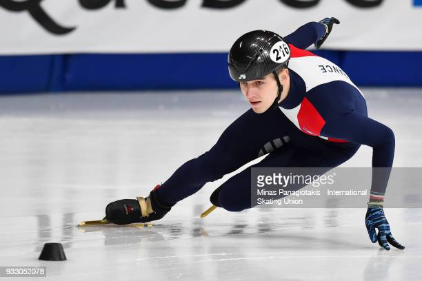 Dmitry Migunov of France competes in the men's 500 meter ranking finals during the World Short Track Speed Skating Championships at Maurice Richard...