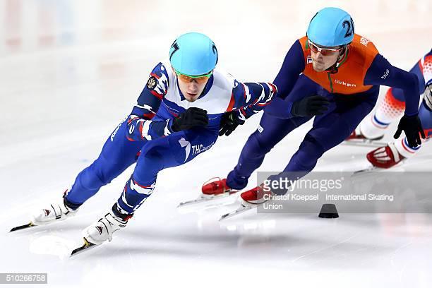 Dmitry Migunov of Russia and Freek van der Wart of Netherlands skate during the men 500m quarterfinals heat one during Day 3 of ISU Short Track World...