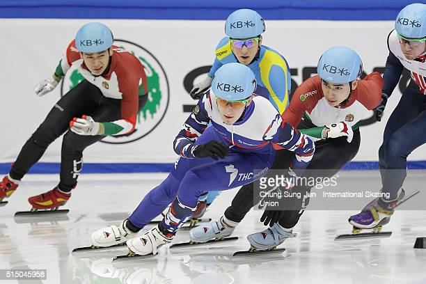 Dmitry Migunov of Russia and Shaolin Sandor Liu of Hungray compete in the Men 500m Semifinals during the ISU World Short Track Speed Skating...