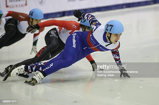 Dmitry Migunov of Russia competes against Samuel Girard of Canada on Day 2 of the ISU World Cup Short Track Speed Skating competition at MasterCard...