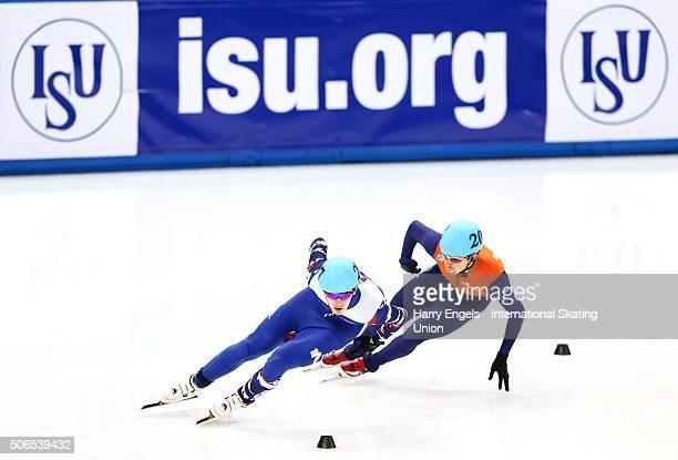 Dmitry Migunov of Russia leads Freek van der Wart of the Netherlands during the Men's 1000m Quarterfinals on day three of the ISU European Short...