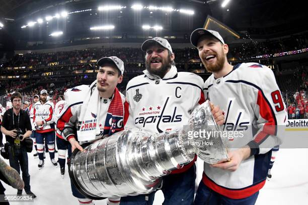 Dmitry Orlov Alex Ovechkin and Evgeny Kuznetsov of the Washington Capitals pose for a photo with the Stanley Cup after their team defeated the Vegas...