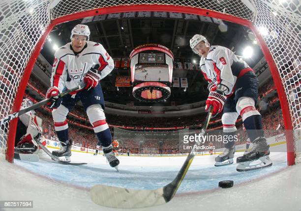 Dmitry Orlov and Madison Bowey of the Washington Capitals attempt to stop a late 3rd period goal from entering their net against the Philadelphia...