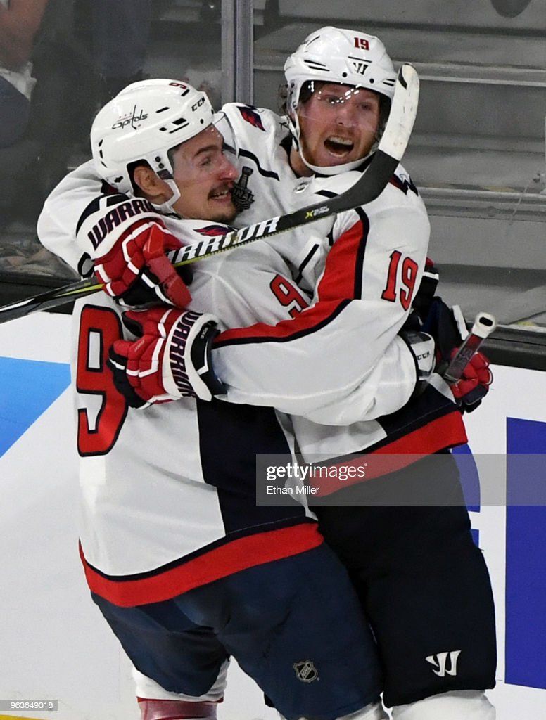 Dmitry Orlov #9 and Nicklas Backstrom #19 of the Washington Capitals celebrate Backstrom's first-period goal against the Vegas Golden Knights in Game One of the 2018 NHL Stanley Cup Final at T-Mobile Arena on May 28, 2018 in Las Vegas, Nevada. The Golden Knights defeated the Capitals 6-4.