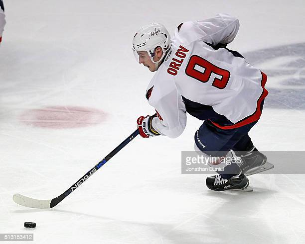 Dmitry Orlov of the Washington Capitals advances the puck against the Chicago Blackhawks at the United Center on February 28 2016 in Chicago Illinois...