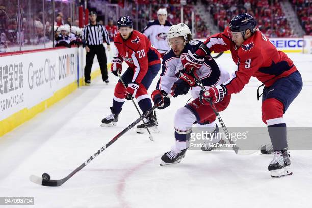 Dmitry Orlov of the Washington Capitals and Artemi Panarin of the Columbus Blue Jackets battle for the puck in the second period in Game Two of the...