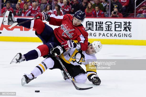 Dmitry Orlov of the Washington Capitals and Conor Sheary of the Pittsburgh Penguins battle for the puck in the second period in Game One of the...