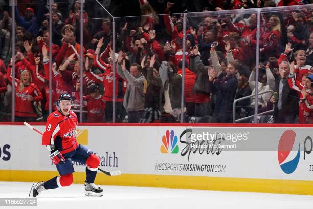 Dmitry Orlov of the Washington Capitals celebrates after scoring the gamewinning goal in overtime against the Tampa Bay Lightning at Capital One...