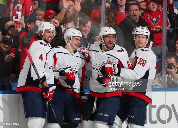 Dmitry Orlov of the Washington Capitals celebrates his third period goal with Brenden Dillon, Alex Ovechkin, and Lars Eller during an NHL game...