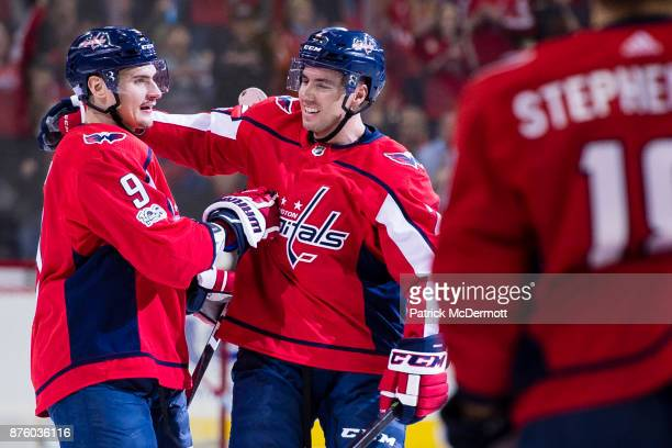Dmitry Orlov of the Washington Capitals celebrates with Matt Niskanen after scoring a first period goal against the Minnesota Wild at Capital One...