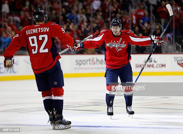 Dmitry Orlov of the Washington Capitals celebrates with teammate Evgeny Kuznetsov after scoring a goal in the second period against the Winnipeg Jets...