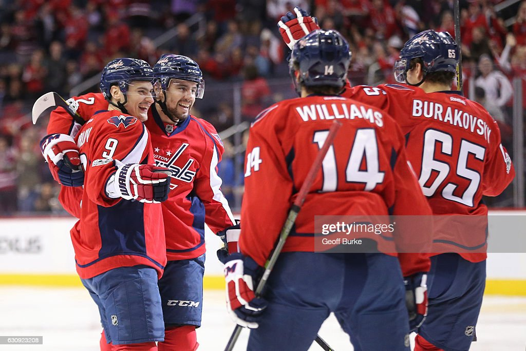 Dmitry Orlov #9 of the Washington Capitals celebrates with teammates after scoring a goal against the Toronto Maple Leafs in the first period at Verizon Center on January 3, 2017 in Washington, DC.