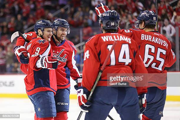 Dmitry Orlov of the Washington Capitals celebrates with teammates after scoring a goal against the Toronto Maple Leafs in the first period at Verizon...