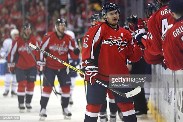 Dmitry Orlov of the Washington Capitals celebrates with teammates after assisting Justin Williams on a goal against the Toronto Maple Leafs during...