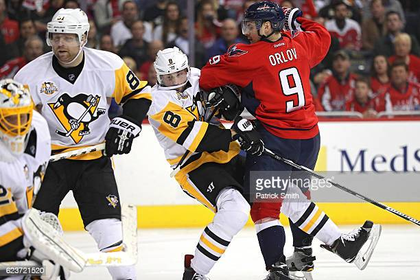Dmitry Orlov of the Washington Capitals collides into Brian Dumoulin of the Pittsburgh Penguins after scoring a goal during the second period at...