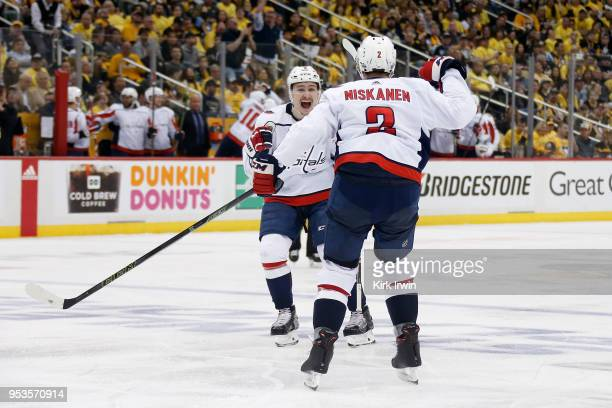 Dmitry Orlov of the Washington Capitals congratulates Matt Niskanen of the Washington Capitals after scoring a goal during the third period in Game...