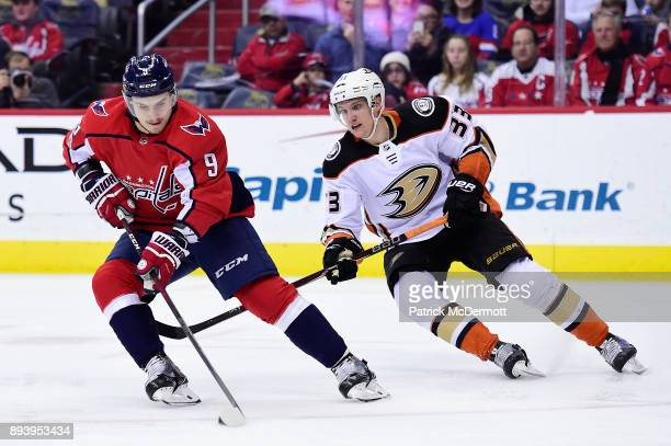 Dmitry Orlov of the Washington Capitals controls the puck against Jakob Silfverberg of the Anaheim Ducks in the second period at Capital One Arena on...