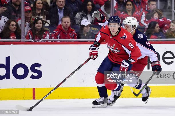 Dmitry Orlov of the Washington Capitals controls the puck against Artemi Panarin of the Columbus Blue Jackets in the first period at Capital One...