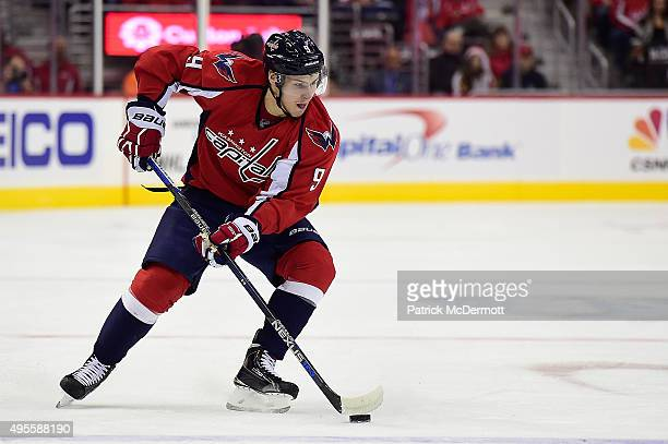 Dmitry Orlov of the Washington Capitals controls the puck against the Columbus Blue Jackets in the first period during an NHL game at Verizon Center...