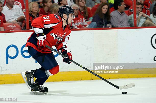 Dmitry Orlov of the Washington Capitals controls the puck in overtime during an NHL game against the Tampa Bay Lightning at Verizon Center on April...