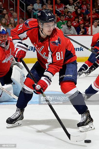 Dmitry Orlov of the Washington Capitals controls the puck in the third period during an NHL game against the Chicago Blackhawks at Verizon Center on...