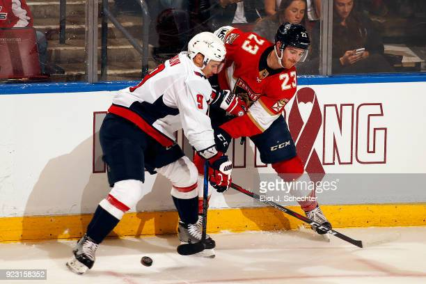 Dmitry Orlov of the Washington Capitals crosses sticks with Connor Brickley of the Florida Panthers at the BBT Center on February 22 2018 in Sunrise...