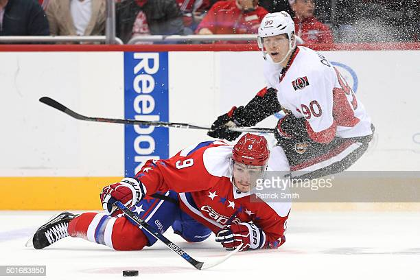 Dmitry Orlov of the Washington Capitals falls to the ice in front of Alex Chiasson of the Ottawa Senators in the first period at Verizon Center on...