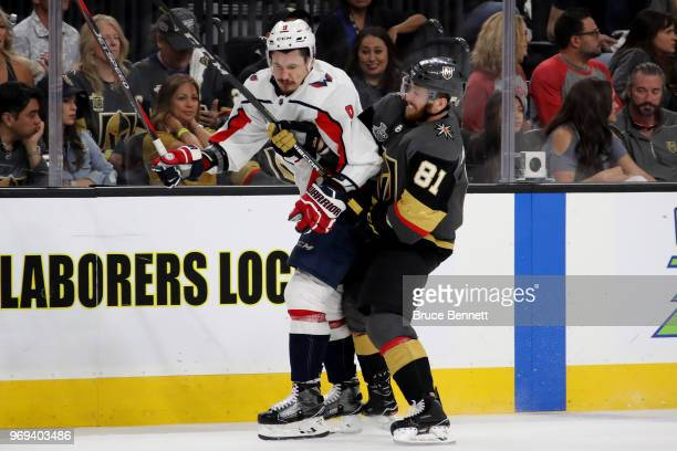Dmitry Orlov of the Washington Capitals is checked by Jonathan Marchessault of the Vegas Golden Knights during the second period in Game Five of the...