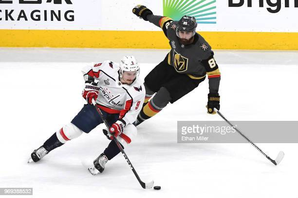 Dmitry Orlov of the Washington Capitals is defended by Alex Tuch of the Vegas Golden Knights during the first period in Game Five of the 2018 NHL...