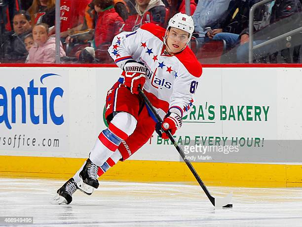 Dmitry Orlov of the Washington Capitals plays the puck against the New Jersey Devils during the game at the Prudential Center on January 24 2014 in...
