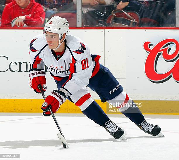 Dmitry Orlov of the Washington Capitals plays the puck against the New Jersey Devils during the game at the Prudential Center on April 4 2014 in...