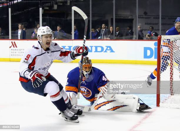 Dmitry Orlov of the Washington Capitals scores at 823 of the third period against Jaroslav Halak of the New York Islanders at the Barclays Center on...