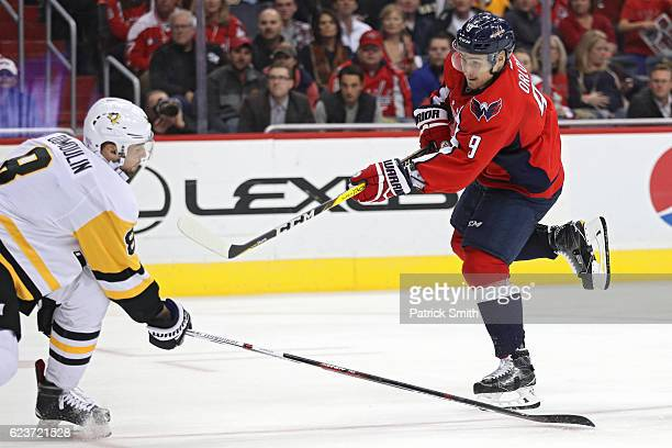 Dmitry Orlov of the Washington Capitals scores goal in front of Brian Dumoulin of the Pittsburgh Penguins during the second period at Verizon Center...