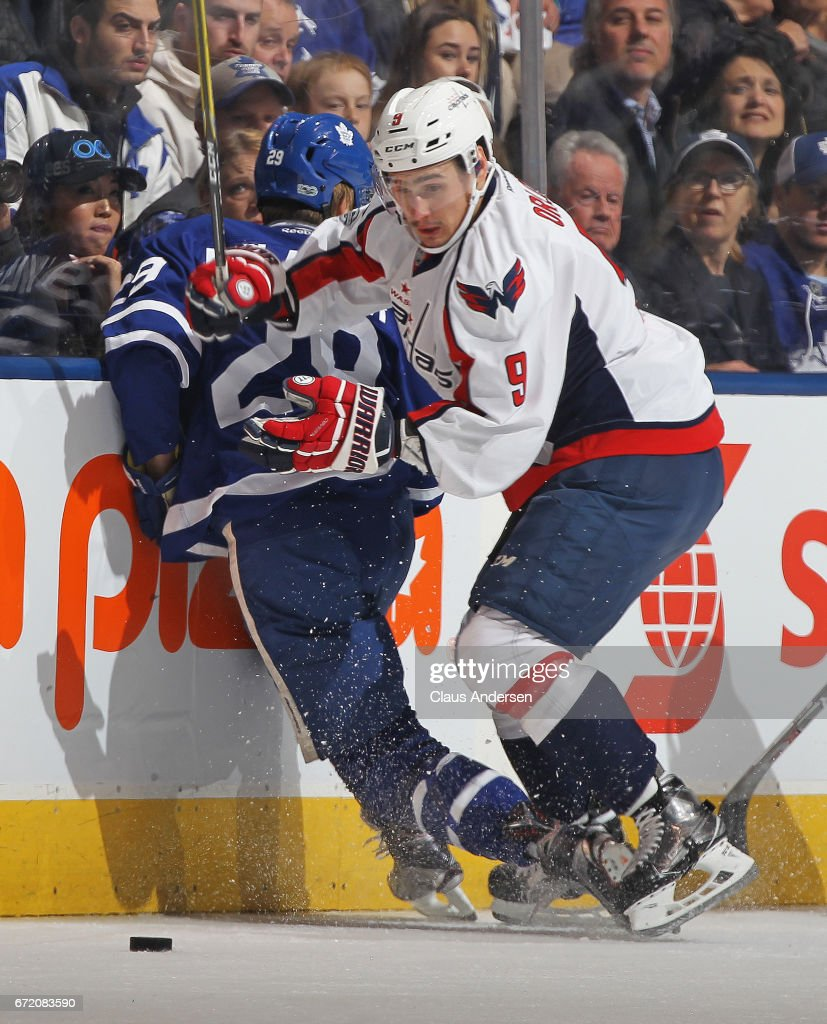 Dmitry Orlov #9 of the Washington Capitals slams Kasperi Kapanen #28 of the Toronto Maple Leafs into the boards in Game Six of the Eastern Conference Quarterfinals during the 2017 NHL Stanley Cup Playoffs at the Air Canada Centre on April 23, 2017 in Toronto, Ontario, Canada. The Capitals defeated the Maple Leafs 2-1 in overtime to win series 4-2.
