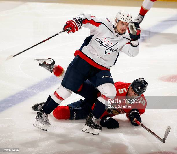 Dmitry Orlov of the Washington Capitals tangles with Aaron Ekblad of the Florida Panthers at the BBT Center on February 22 2018 in Sunrise Florida