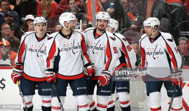 Dmitry Orlov Taylor Chorney Marcus Johansson Evgeny Kuznetsov and Justin Williams of the Washington Capitals react following a third period goal...